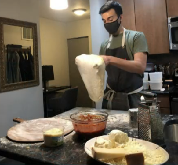 Ben making pizza